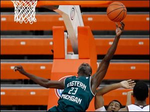 Bowling Green State University guard Anthony Henderson (2) defends against  Eastern Michigan University forward Glenn Bryant (23).