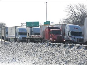 Traffic is stopped on northbound I-75 just south of downtown Toledo shortly after noon today following an incident involving a semi.