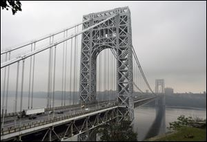 Traffic moves across the George Washington Bridge in Fort Lee, N.J.. A top aide to New Jersey Gov. Chris Christie is linked through emails and text messages to a seemingly deliberate plan to create traffic gridlock in a town at the base of the bridge after its mayor refused to endorse Christie for re-election.