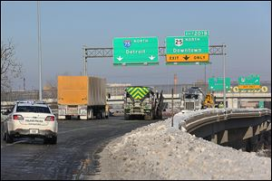 Traffic backs up on northbound I-75 south of downtown Toledo shortly after noon Thursday after an accident involving a semi. Most of the city's main routes were clear, probably aided by Ohio's authority to declare weather emergencies.