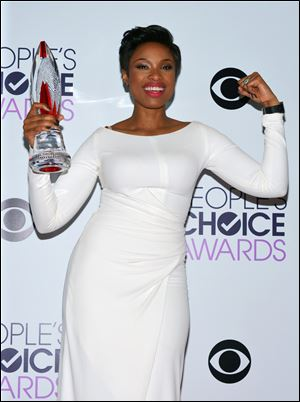 Jennifer Hudson poses with the award for favorite humanitarian at the 40th annual People's Choice Awards at Nokia Theatre L.A.
