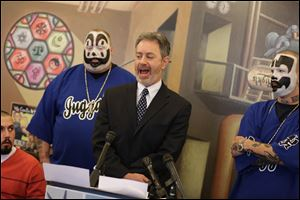 Insane Clown Posse members flank Michael Steinberg, legal director of the ACLU of Michigan, who announced that the ACLU has filed suit over an FBI report that describes the rap-metal duo's fans  as dangerous.