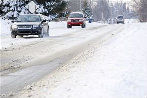 Monroe County motorists, such as these on West Sterns Road near Lewis Avenue, were hampered by snow and ice pack that remained for a fourth day on primary and secondary travel routes.