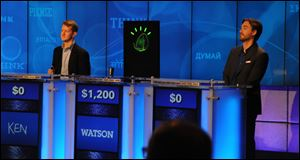 IBM's Watson computer system, powered by IBM POWER7, competes against Jeopardy!'s two most successful and celebrated contestants -- Ken Jennings and Brad Rutter --  in a practice match in January, 2011.