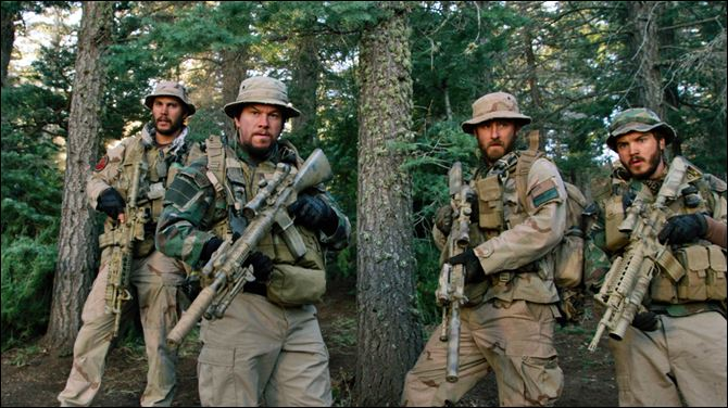 "Film Review-Lone Survivor From left, Taylor Kitsch, as Michael Murphy, Mark Wahlberg as Marcus Luttrell, Ben Foster as Matt ""Axe"" Axelson, and Emile Hirsch as Danny Dietz in a scene from the film, ""Lone Survivor."