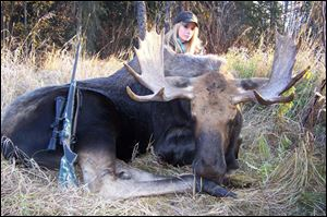 Katelyn Spalding shot this bull moose in Alberta late in 2013 at about 250 yards just after sunrise. The moose weighed 1,100 pounds and his rack measures 40 inches with 16 points.
