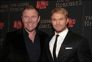 "Director Renny Harlin, left, and actor Kellan Lutz, right, attend a screening of ""The Legend of Hercules"" on Monday, Jan. 6, 2014, in New York."