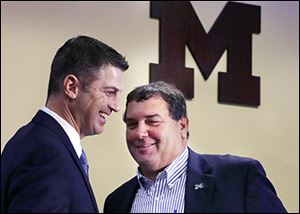 Doug Nussmeier, left, and Michigan coach Brady Hoke are all smiles Friday after Nussmeier was introduced as the Wolverines' new offensive coordinator.