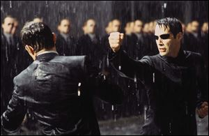 Keanu Reeves, right, fights Hugo Weaving in a scene from 'The Matrix Revolution.'