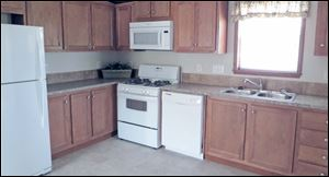 Home chefs will love cooking in this large, eat-in kitchen. Quality Whirlpool appliances are included.