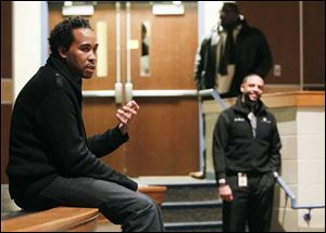 David Johns, executive director of the White House Initiative on Educational Excellence for African-Americans, talks to Woodward High students as Romules Durant, superintendent of Toledo Public Schools, looks on at right.  Mr. Johns spoke Friday at the school.
