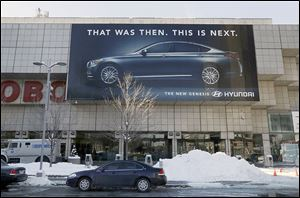 A Hyundai Genesis banner is displayed outside Cobo Center, home of the North American International Auto Show, in downtown Detroit. More than 500 vehicles are expected to be on display.