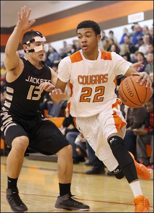 Southview's junior Jeremiah Roberts drives past Perrysburg's Kenny Zimmerman. The Cougars improve to 7-2, 3-2 in the Northern Lakes League. The Yellow Jackets fall to 9-1, 4-1.