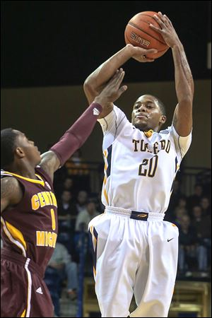 Toledo point guard Julius Brown shoots a 3-pointer against Central Michigan. Brown had 15 points and 12 assists.