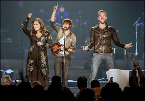 An enthusiastic Hillary Scott, Dave Haywood, and Charles Kelley entertain the sold-out Huntington Center as part of the second stop on the group's Take Me Downtown tour.