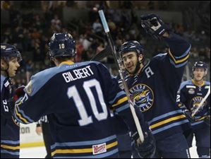 The Walleye's Trevor Parkes, right, congratulates David Gilbert on his goal during the first period.