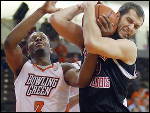 BG's Spencer Parker fights for the rebound with Northern Illinois' Pete Rakocevic.