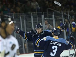 Richard Nedomlel, left, is congratulated by Walleye teammate C.J. Chartrain after scoring a goal.