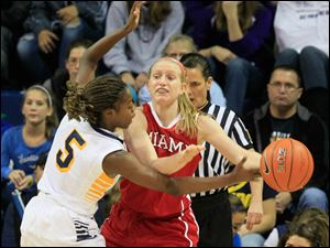 UT's #5, Janelle  Reed-Lewis defending  MU's #14, Courtney Larson. UT would force 20 turnovers while turning the ball over 12 times.