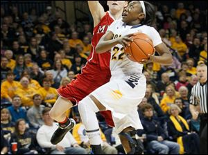 UT's Andola Dortch is fouled by Miami's Kindsay Brandt.