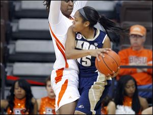 The Falcons' Alexis Rogers defends Akron's Anita Brown.