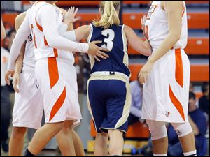 Akron's Kacie Cassell, center, shoves her way between BG players Erica Donovan, left, and Jill Stein.