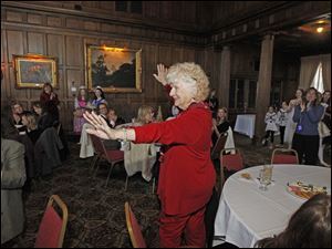 Marie Vogt gets applause by the participants at the annual Tea with Clara and Friends.