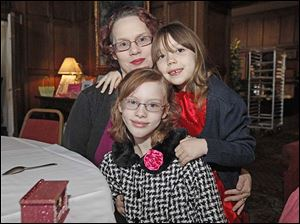 Christina Peterson, left, with Serena Peterson, 8, center with glasses and plaid coat, and Si' Ana Wilson 7, right, enjoy the annual Tea with Clara and Friends.