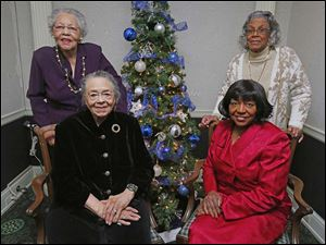 Dorothy Smith, back left, Diana Minor, back right, with Dora A. Garner, front left, and Laura Palmer, front right, at the Coterie Christmas party at the Toledo Club.