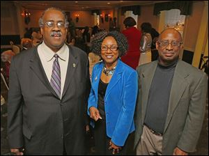Harry Brown, left, Shirley Crockett and laMont Stewart, right, at the Coterie Christmas party at the Toledo Club.