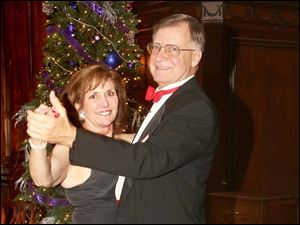 Anne and Dan Thomas attended the Cotillion Club Dinner Dance at the Toledo Club.