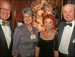 Peter Handwork, left, event co-chairman Claudia Handwork, center left, event co-chairman Judy Dye, center right, and Nick Dye, right, attended the Cotillion Club Dinner Dance at the Toledo Club.