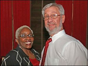 Cheryl and John Folsom, of downtown Toledo, attended the Junior League party at the Toledo Club.