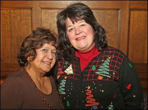 Christina Hulbirt, of South toledo, left, and Pam Shanks, of West Toledo attended the Junior League party at the Toledo Club.