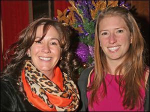 Cindi Plummer, of Bryan, left, and Sarah Duvall, of Maumee, right, attended the Junior League party at the Toledo Club.