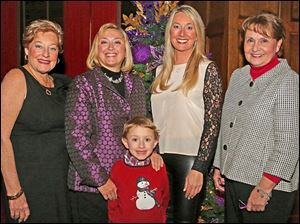 Co-chair Suzie Hahn, left, Clare Gorski, center left, Charlie Gorski, 6, center, co-chair Linsey Ansberg, center right, Marsha Molmar, center right, attended the Junior League party at the Toledo Club.