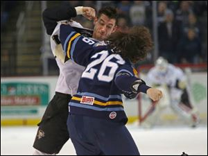 Wheeling's Shane Bakker, left, fights Toledo's Emerson Clark during the second period.