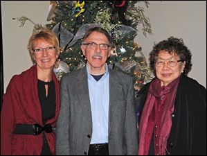 Registry Bistro Manager Vickie Rapp, Alliance Francaise de Toledo Board Member Tom Reed & Alliance Member Marj Baril.