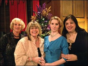 From left to right is Rosemary Cohen, jewelry designer from  New York, Joy Hyman-Goldberg  Chair, Eileen Eddy and her daughter, Alana, who sang  a variety of holiday and classical  songs throughout the evening.