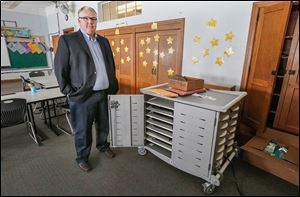 Northwood Superintendent Greg Clark shows a laptop storage unit at Northwood Elementary. Janitors must unplug computers when vacuuming so no fuses are blown; the room has 20 amps of service.