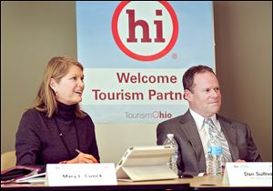 In this Dec. 19, 2013 photo provided by the Ohio Development Services Agency, Mary Cusick, left, director of TourismOhio, and Dan Sullivan, president of HNS Sports Group, listen to fellow members of the Tourism Ohio Advisory Board at their first meeting in Columbus, Ohio. Cusick stepped into her role in early December. She and the board are tasked with developing ways to market the state and boost the number of visitors to Ohio. (AP Photo/Ohio Development Services Agency)