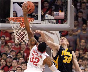 Ohio State's Lenzelle Smith, Jr., tries to dunk the ball over Iowa's Aaron White. Smith finished the game with 10 points.