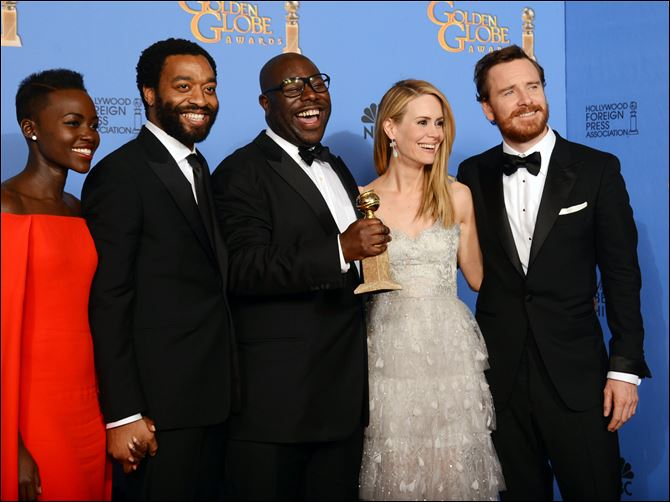 71st Annual Golden Globe Awards 12 1-12 From left, Lupita Nyong'o, Chiwetel Ejiofor, Steve McQueen, Sarah Paulson, and Michael Fassbender pose in the press room with the Golden Globes' top honor, best film drama, for '12 Years a Slave' on Sunday night.