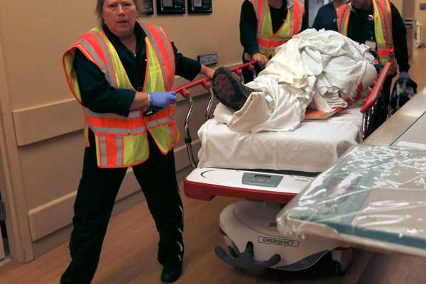 Life-Flight-workers-wheel-a-vehicle-accident-trauma-patient-in
