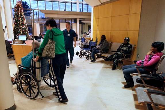 Stefan-Slak-is-wheeled-into-a-triage-room-by-his-wife-Hewen