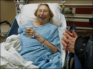 Patient Ruth Conway shares a laugh with a family visitor before being discharged for a lung infection at the University of Toledo Medical College ER.