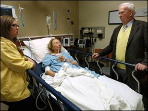 RN Amanda Anderson talks to patient Ruth Conway and her husband Dr. Lawrence Conway prior to her being discharged from the University of Toledo Medical College ER.