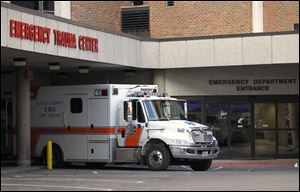 An ambulance at Mercy St. Vincent Medical Center in Toledo is parked after dropping off a patient. Mercy St. Vincent is one of three Level 1 trauma ERs in the city.