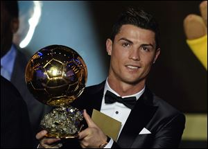 Cristiano Ronaldo of Portugal is awarded the prize for the FIFA Men's soccer player of the year 2013 at the FIFA Ballon d'Or 2013 gala Monday at the Kongresshaus in Zurich, Switzerland.
