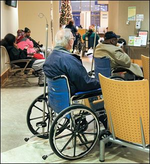 Patients wait to be treated at the ProMedica Toledo Hospital emergency room. Toledo area hospitals are focused on faster care and improving customer service.